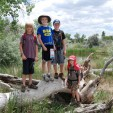 Old snags and young hikers at Walden Ponds.