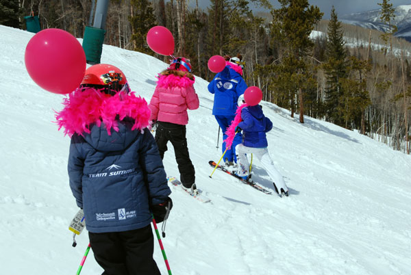 Boas and balloons during the Ski Girls Rock lesson.