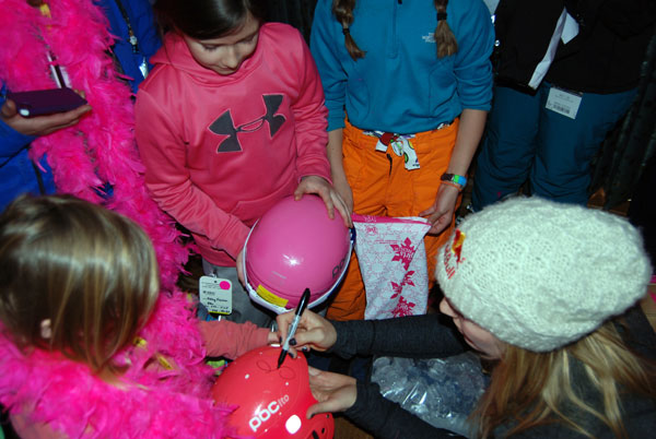 Lindsey Vonn signs Anya's helmet. Unlike some of the girls, my daughter took a pass on the forehead signing.