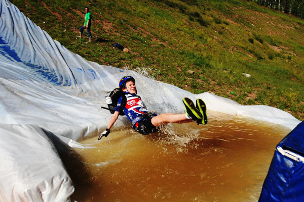 Kids get so much speed on the slip-n-slide, they pond skim on their butts.