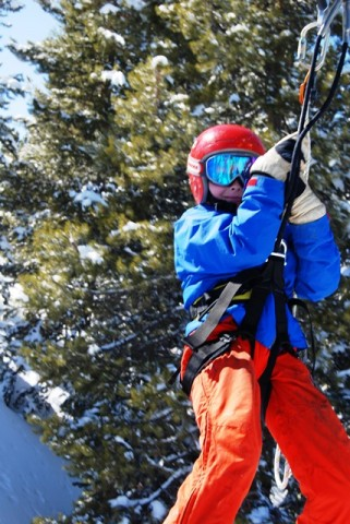 Hanging on tight on the zipline at Vail.